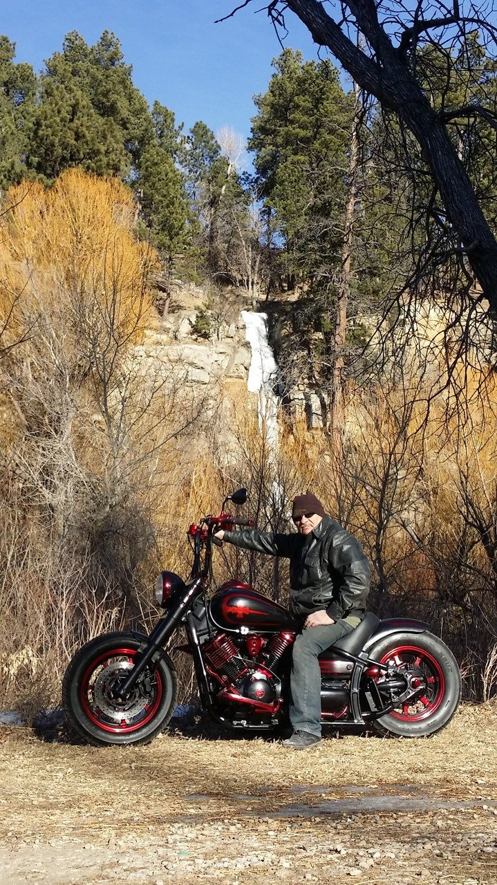 yamaha v-star classic bobber in the woods